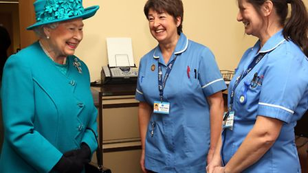 Queen Elizabeth II meets nurses Sarah Wallis and Daniela Reynolds (right) during a visit to The Norf
