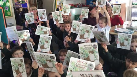 St Giles' C of E School with their Mog books