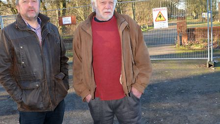 Panshanger campaigners Will Davis and Jerry Larke at the gates of the Panshanger Aerodrome site