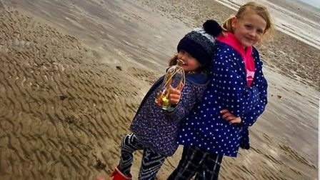 Five-year-old Gracie and nine-year-old Poppy at Huntstanton beach before they sent their message in
