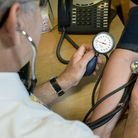 A GP checks a patient's blood pressure. Photo credit: Anthony Devlin/PA Wire