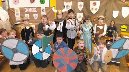 The photos at Walpole show the children eating their Viking Banquet watching leg wrestling, George F