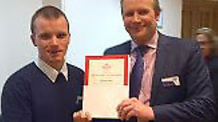 Nathan Clark of Welwyn Garden City receives his certificate after completing a progranne with the Pr