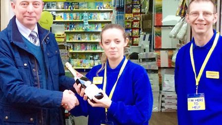 Horsefair centre manager, Kevin Smith, presents store manager of The Works, Sam Yates, with a bottle