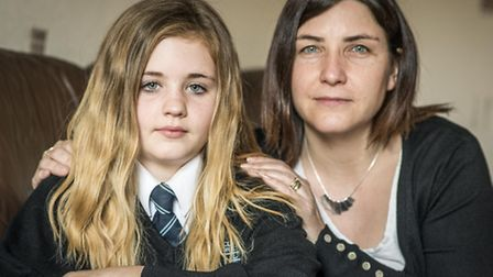 Katie Sutton with her daughter Lily Sutton, are unhappy that the school bus ticket has increased fro