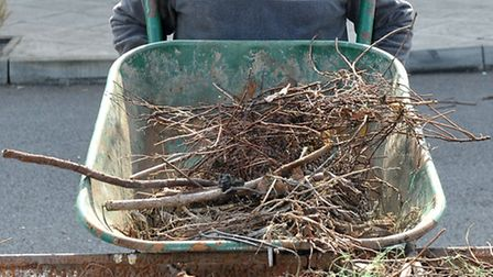 Glennfield Care Centre's Big Dig as part of National Gardening Week. David clearing rubbish into the