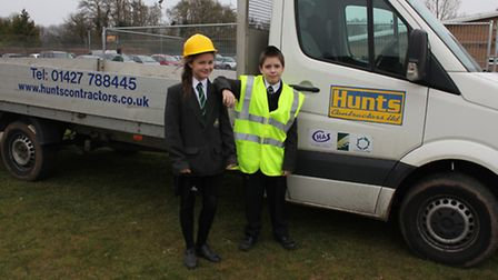 Louise Hill and Sam Morfill, from Year 7, oversee the construction of the netball courts
