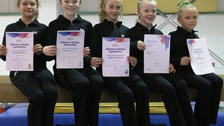 Fenland Gymnastic Academy members, with their successful grading certificates.
