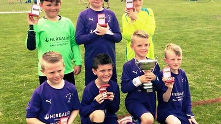 Wisbech St Mary Purples under 8s, who haven't lost a league game for two seasons, celebrate their Wh