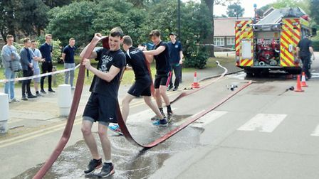 CWA uniformed services competing in the fire service challenge