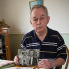 Stan Bolton with photos of his prized canaries canaries before they died.