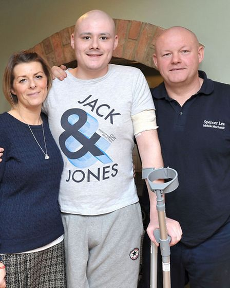 Billy Lee with his Mum and Dad, Bex and Spencer at home in Wisbech St Mary.Picture: Steve Williams.