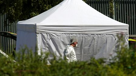 A scenes of crime officer at the scene near Castle Swimming Pool in Spalding, Lincolnshire. Photo: C