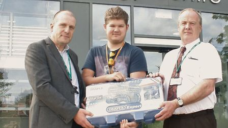 Howard Burton, Stores Manager of AT Johnson presents Liam with his socket set and Steven Young, Sale
