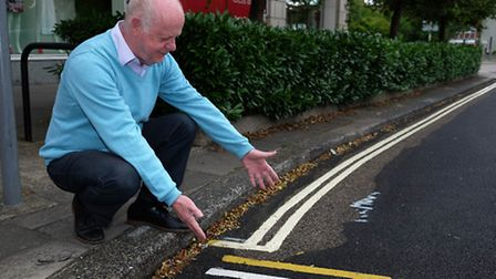 Cllr Malcolm Cowan with the double yellow lines on Wigmores North which have been painted the wrong