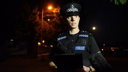 Inspector Nathan Franklin reads a statement at RAF Marham after a man was threatened with a knife