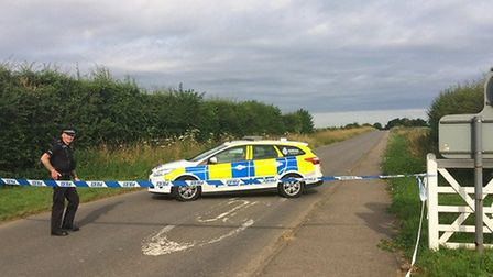 Police seal off a section of Ladywood Road close to RAF Marham in Norfolk, after a serviceman was th