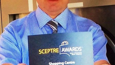 Kevin Smith, of the Horsefair in Wisbech, with the centre's award for innovation