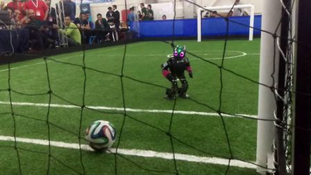 The University of Hertfordshire's Bold Hearts robot football team scoring a goal