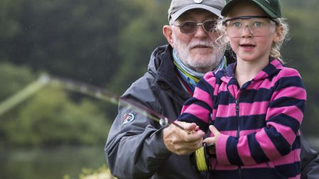Fly fishing / casting practice for a young girl at the CLA Game Fair 2015 - Harewood House, Leeds