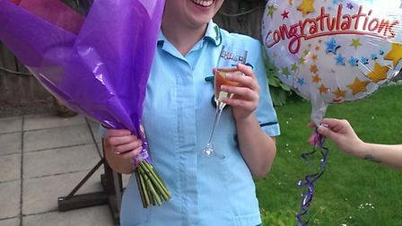 Hollie celebrating after qualifying as a royal veterinary nurse.