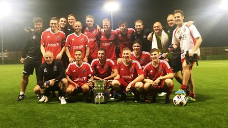 Wisbech Town celebrate their Cambridgeshire FA Invitation Cup victory over Cambridge City. Photo: Sp