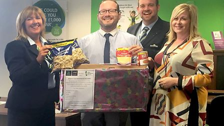 The team from the Wisbech branch of The Nottingham in store with the foodbank collecting box: Tracy