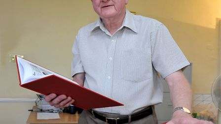 George Dunlop with his books that tell the story of the Wisbech fire service. Picture: Steve William