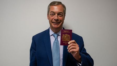 Nigel Farage with his new passport. Photograph: Twitter.