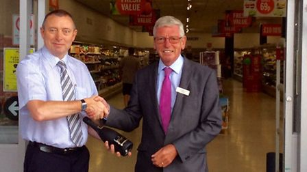 Kevin Smith, centre manager of the Horsefair, welcoming Budgens store manager, Keith Grass, to Wisbe