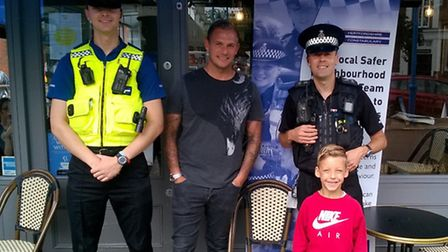 PC Paul Francis, PCSO Chris Lake and customer Brett with his son Stanley