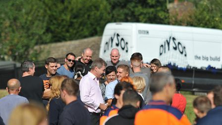 Crowds of local tradespeople who worked on the DIY SOS build gather ahead of the reveal to the famil