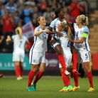 England's Danielle Carter (top) celebrates the opening goal with team mates during the UEFA Euro 201