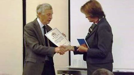 Diane Calton Smith receives her award from local historian, Mike Petty.