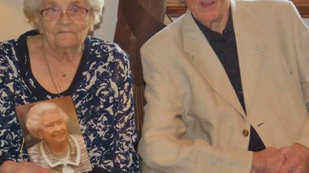 Jean and Colin Hutchinson with their card from the Queen.jpg