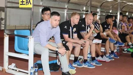 Shanghai Shenxin's management team including Gary White and Louis Lancaster