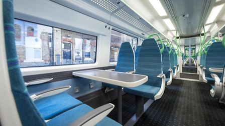Tables and power sockets on the new trains