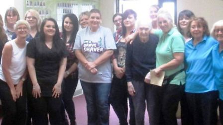Claire with residents, staff, relatives and friends.