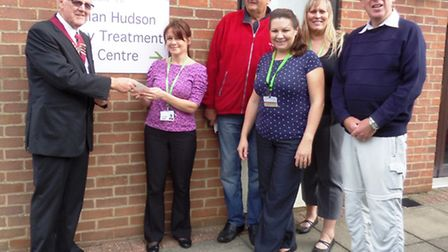 CMB chairman, Mel Joyce presents a cheque for £400 to staff from the Alan Hudson Palliative Care uni