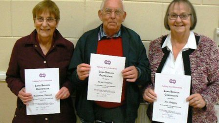 Madeleine Johnson, Peter Fewster and Ann Shippey with their certificates.