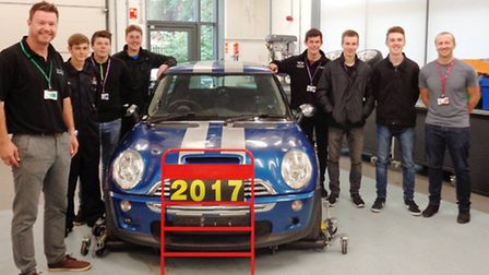 Neal Clarke (left) and John Paul Latham (right) with motorsport students at CWA Wisbech, pictured wi
