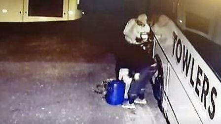 CCTV showing the men stealing the fuel.