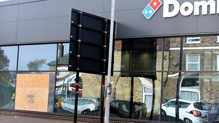 Domino's pizza window boarded up