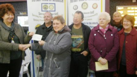 Wisbech Rotary Club president Valerie Smith handing the cheque to stroke club chairman Gillian Sadle