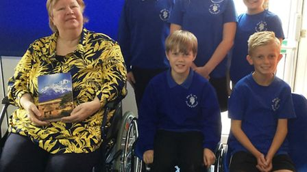 Wisbech author Fiona Ross with children at Elm Primary School.