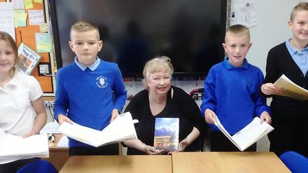 Fiona Ross with children at Elm Primary School.