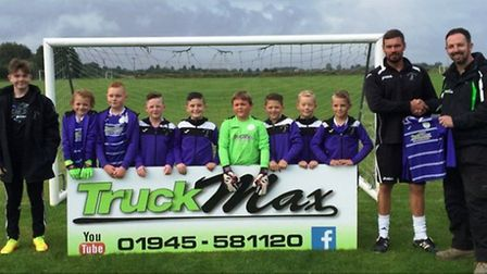 Wisbech St Mary Purples under 9s show off their newly-sponsored kit.