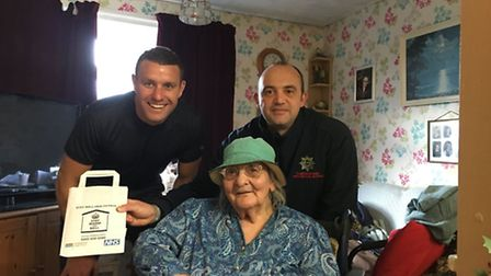 Pearl, 92, with Cambridgeshire firefighters Kev Gilbert and Gary Reach.