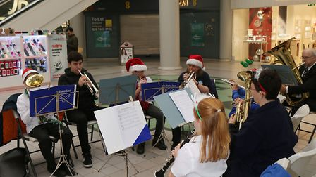 The Wroxham School perform Christmas carols in the Howard Centre.