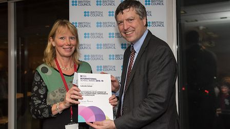 Tanis Laing accepting the award from Sir Ciaran Devane, CEO of the British Council Picture: James G